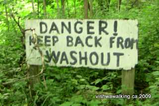 Ganaraska trail, north of Hope township's 5th line, warning sign re a washout.