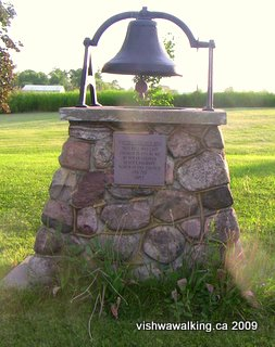 Hoards Station,locally-made bell displayed on the lawn at Hoards United Church
